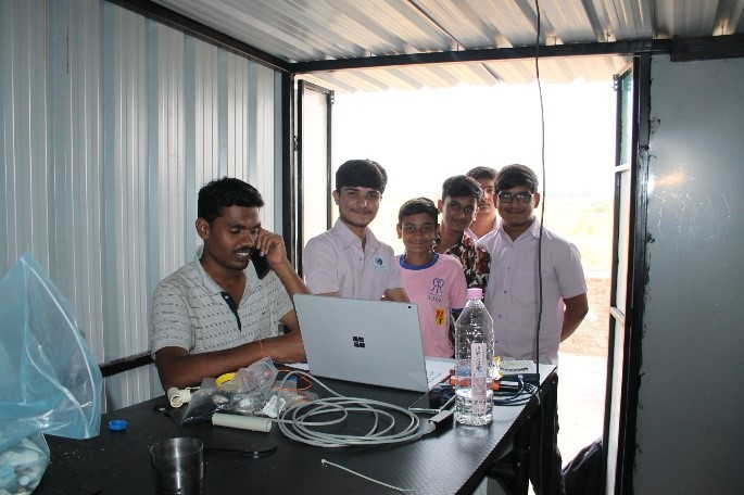 Working with local partners: explaining the REvivED water desalination system to students from the Ultravision School, Padti, India