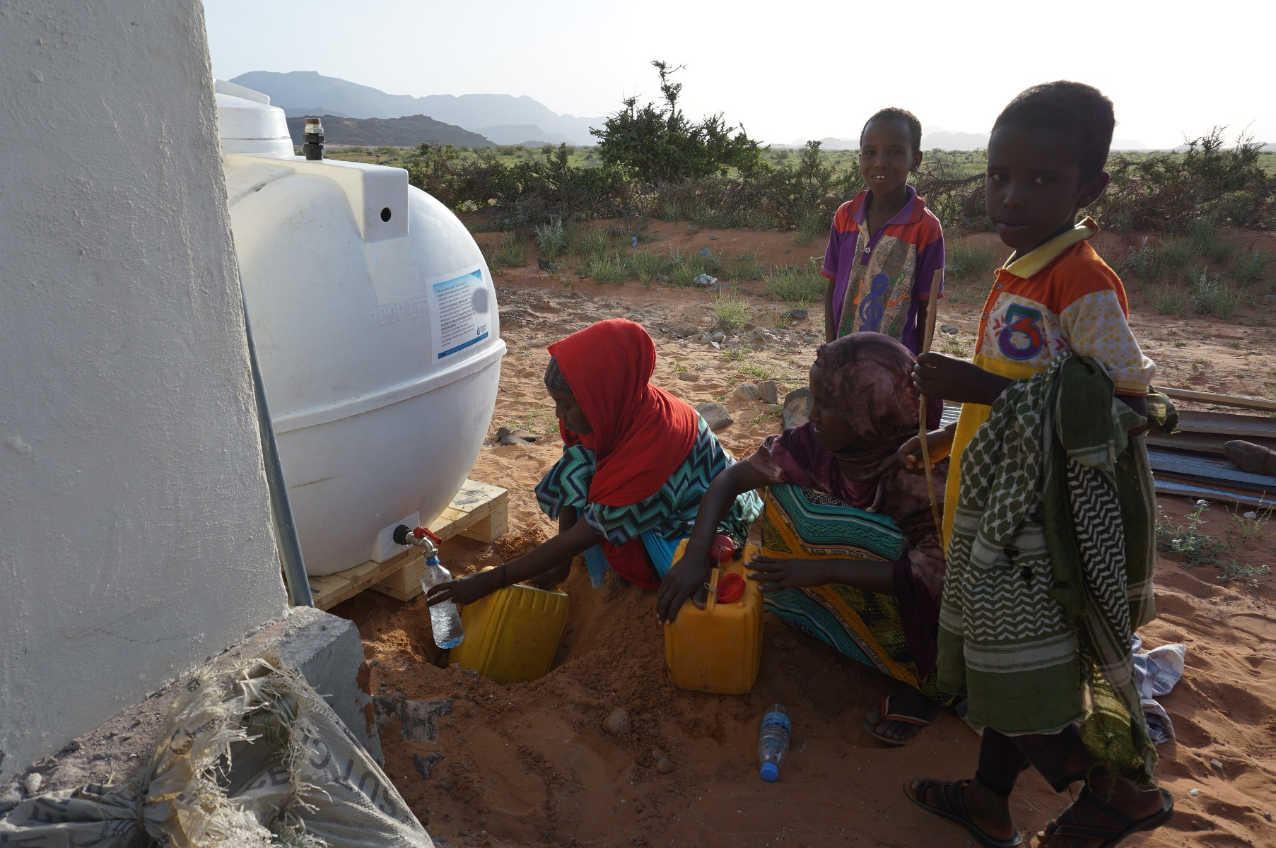 Locals take newly desalinated water from the REvivED water tank